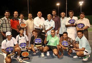 Winning moment:Sandeep Mittal (fifth from left), Deputy Inspector General of Police, Ramanathapuram range, giving away prizes to the winners of tennis tournament in Ramanathapuram on Sunday.— Photo: L. Balachandar