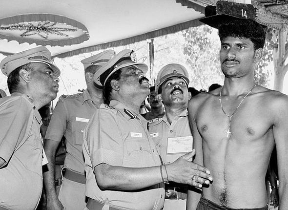 For a job:(From left) N. Arivuselvam, DIG, centre, inspecting physical fitness test of a candidate at the Armed Reserve Police Grounds in Dindigul on Tuesday. PHOTO: G. KARTHIKEYAN; a similar scene in Ramanathapuram and Tuticorin. Photos: L. Balachandar and N. Rajesh; candidates participating in a physical endurance test at Armed Reserve Grounds in Madurai.Photo: R. Ashok