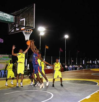 All in the game: Players at the newly inaugurated basketball court in Ramanathapuram on Wednesday. — Photo: L. Balachandar