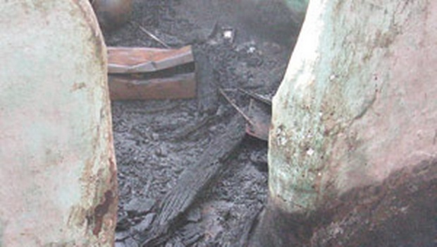 CHARRED REMNANTS: A portion of a house that was burnt down in a clash at W Pudupatti Village on Sunday