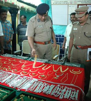 NICE: Deputy Inspector General of Police (Madurai Range), Sandeep Mittal, and Superintendent of Police, M. Manohar, inspecting the stolen goods. Photo: G. moorthy