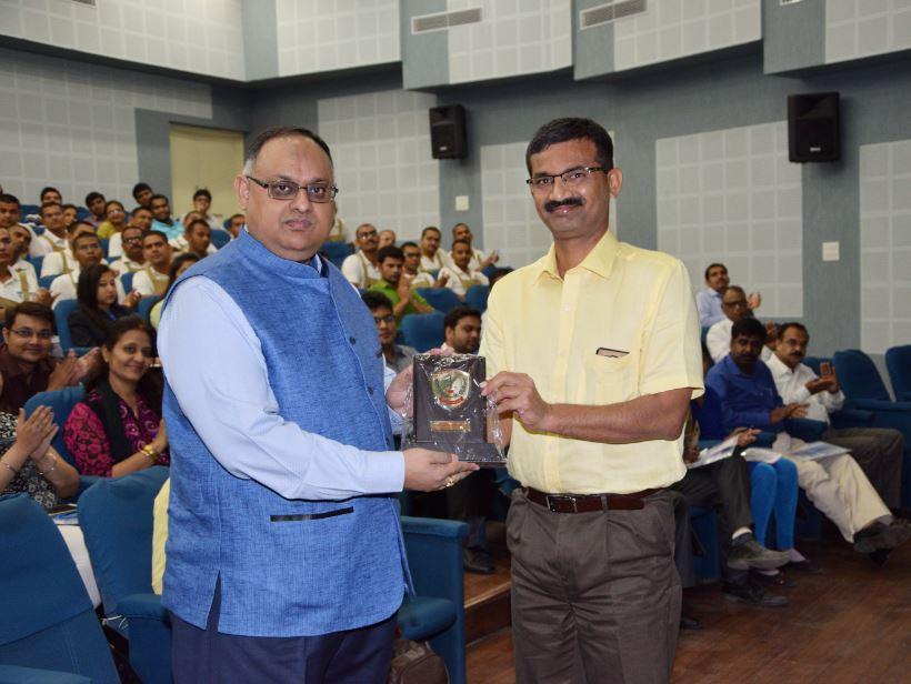 Sh. Vikas Sahay, IPS, Director General presenting memento to Sh. Sandeep Mittal, IPS, DIG, NICFS