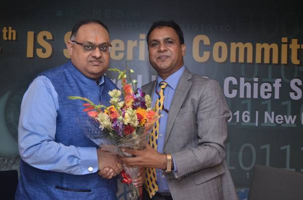 Shri Devesh Chandra Srivastava, IPS, Executive Director-Chief Security, ONGC being presented a bouquet of flowers to Shri Sandeep Mittal, IPS,