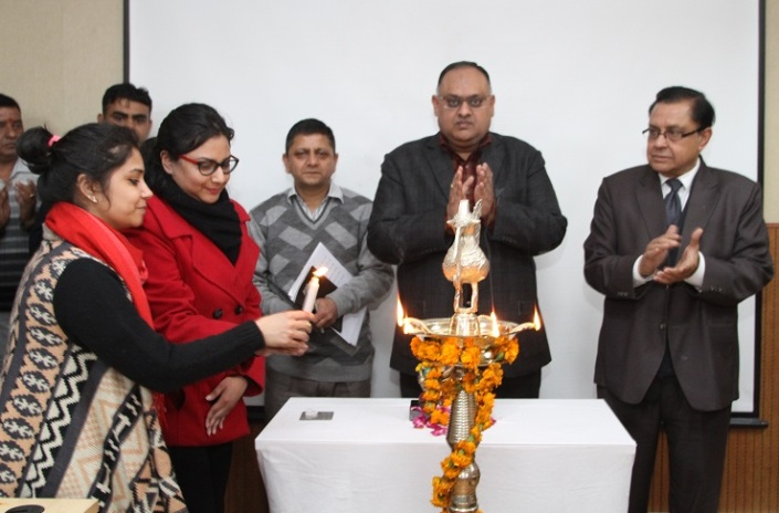 Teacher/students lighting lamp & invoking Godess Saraswati on the occasion of Basant Panchmi